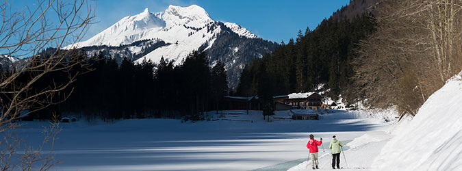 Cross country skiing at Montriond Lake
